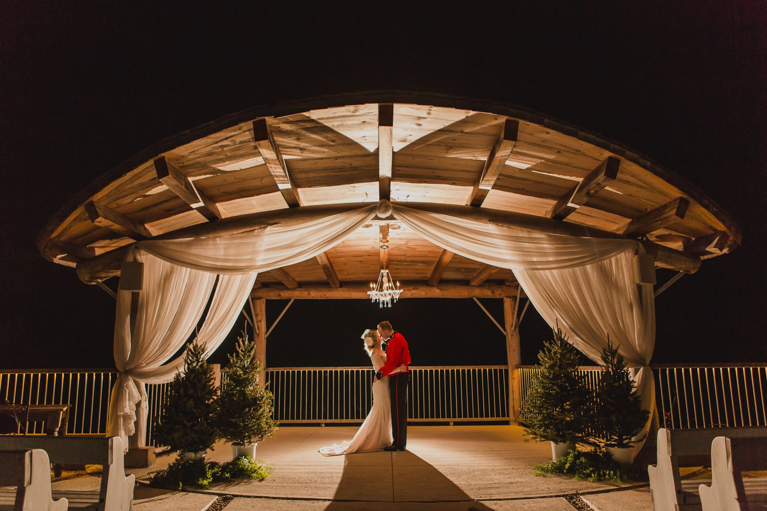 A night time portrait of the bride and groom at Le Belvedere in Wakefield Quebec