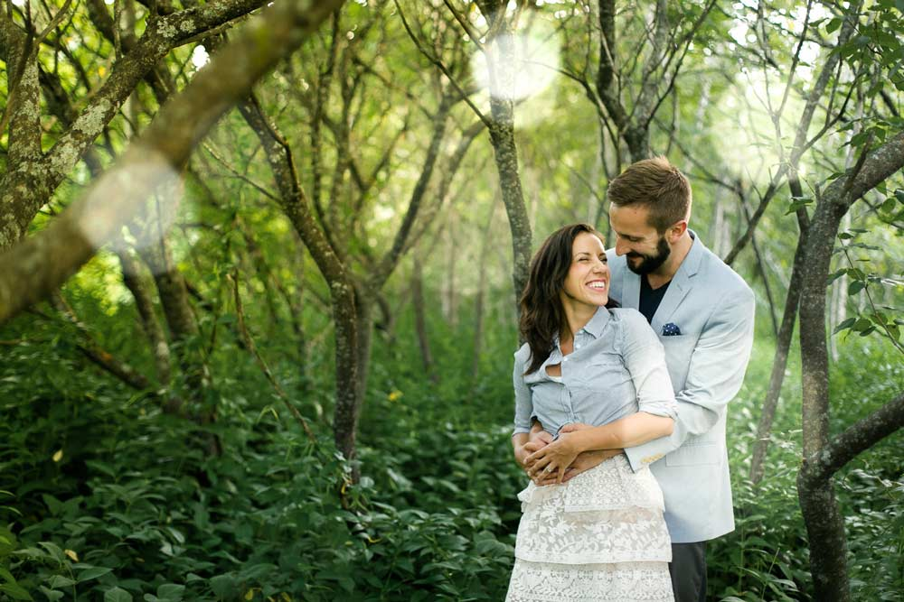 photograph of an engaged couple in a forest in ottawa