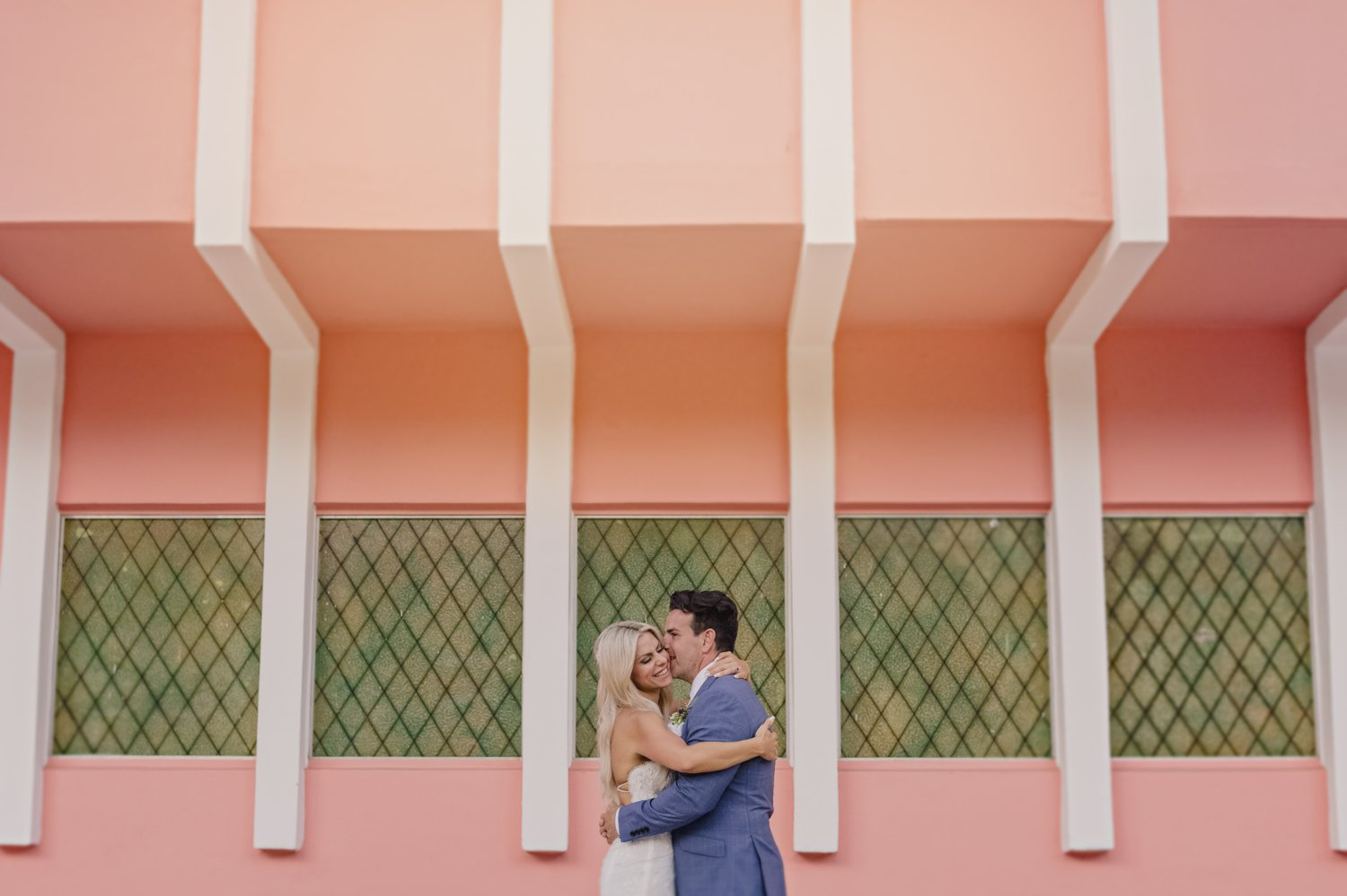 wedding couple portrait on a pink wall in miami florida w hotel south beach