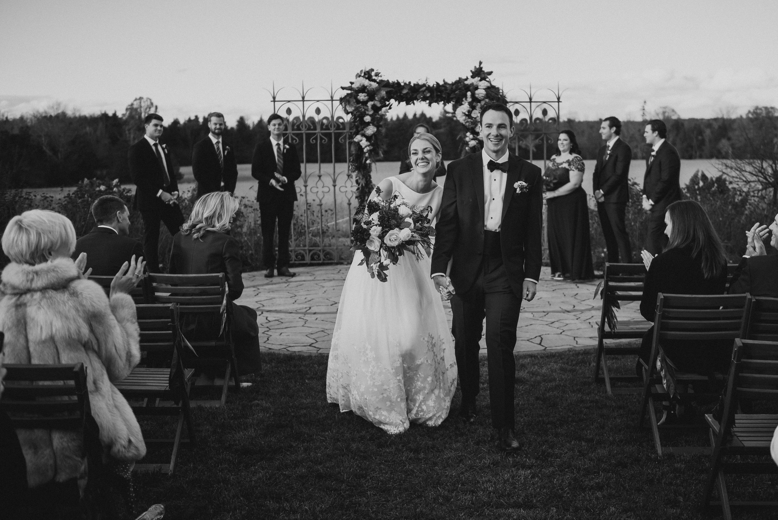 Bride and groom walking down the isle at their evermore wedding