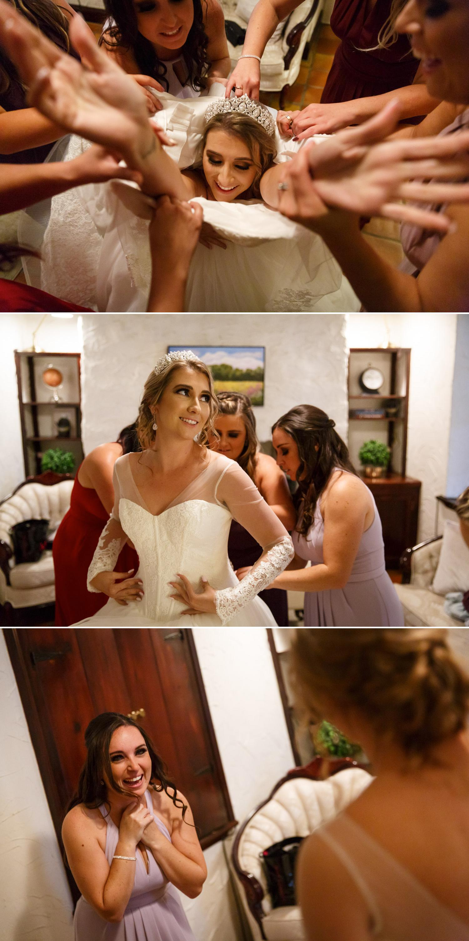 bride getting her makeup done and wedding dress on