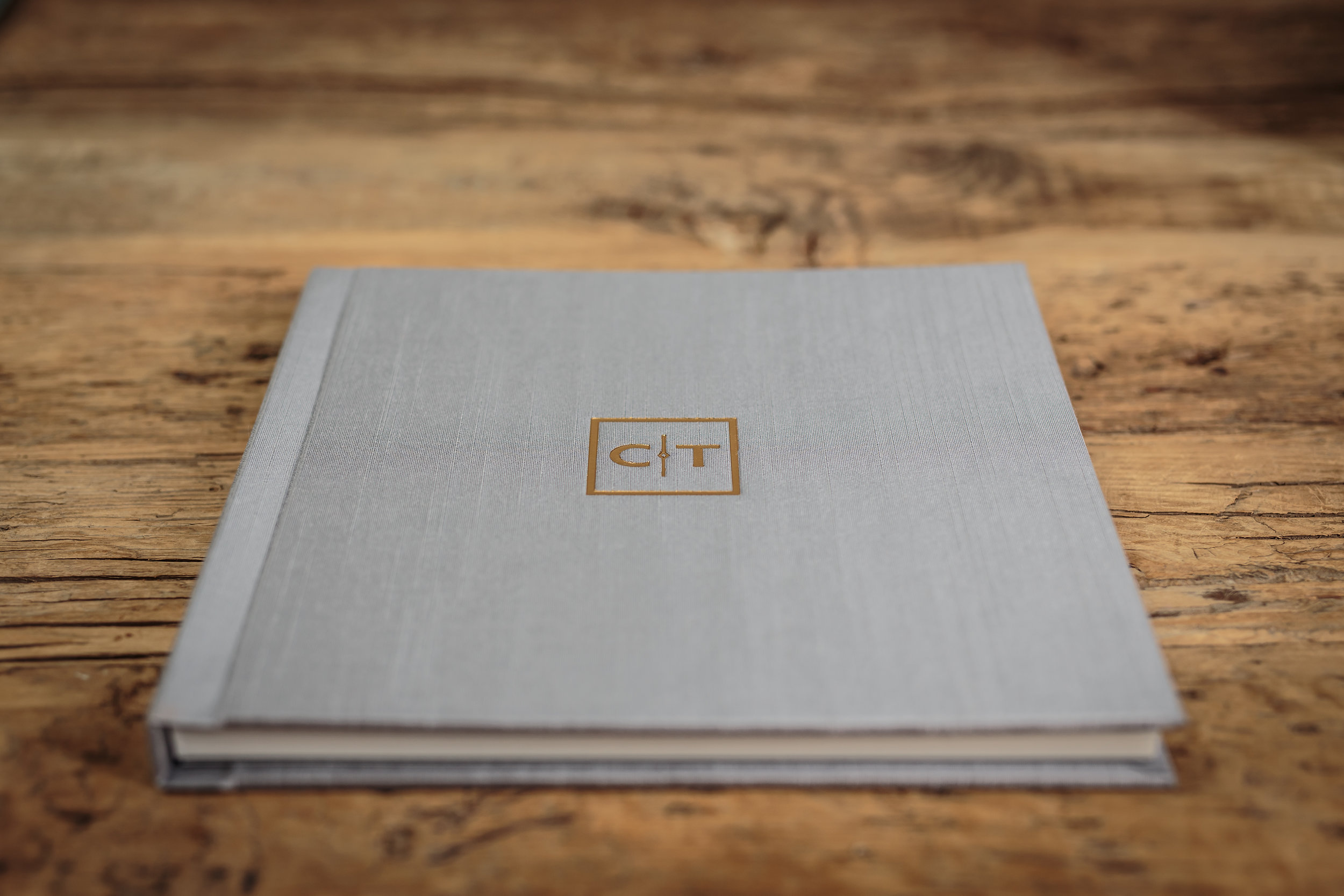 wedding album with a grey cloth cover and imprtinting