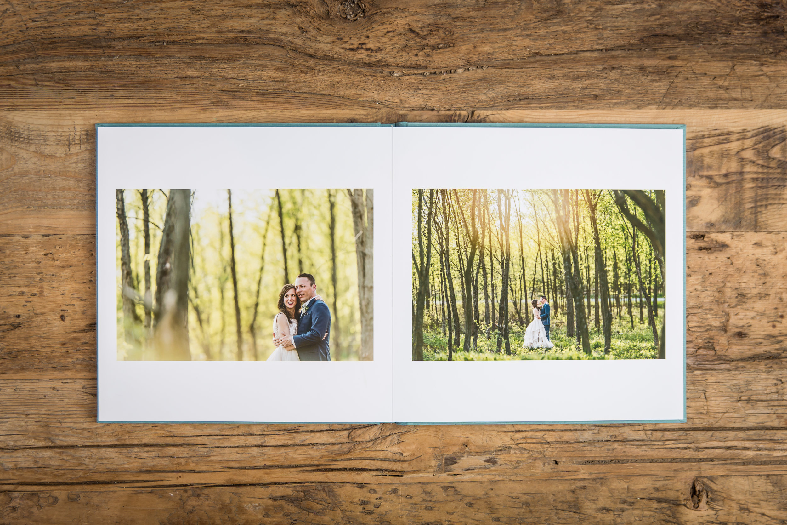 an example photograph or a wedding album on a wooden table