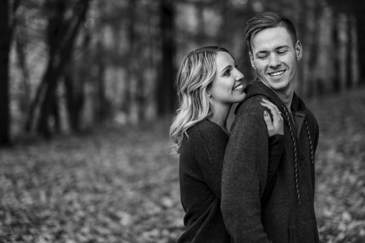 black and white photo of an engaged couple on the grounds of mackenzie king estate in gatineau park during the fall