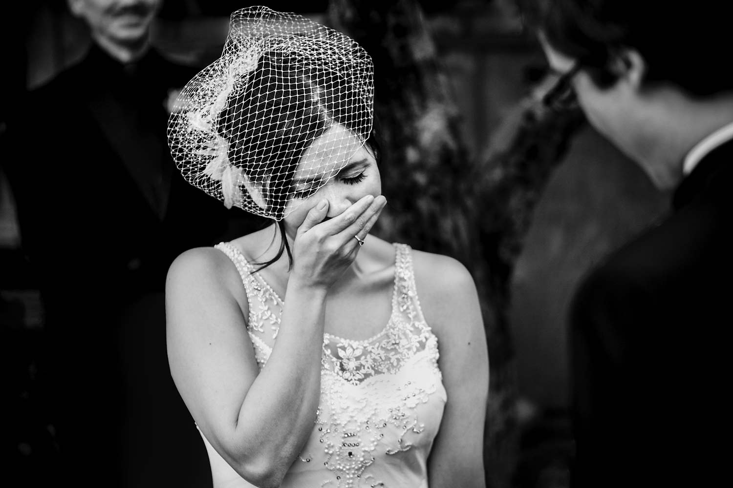 photo of an emotional bride during wedding ceremony at stonefields estate in carleton ontario