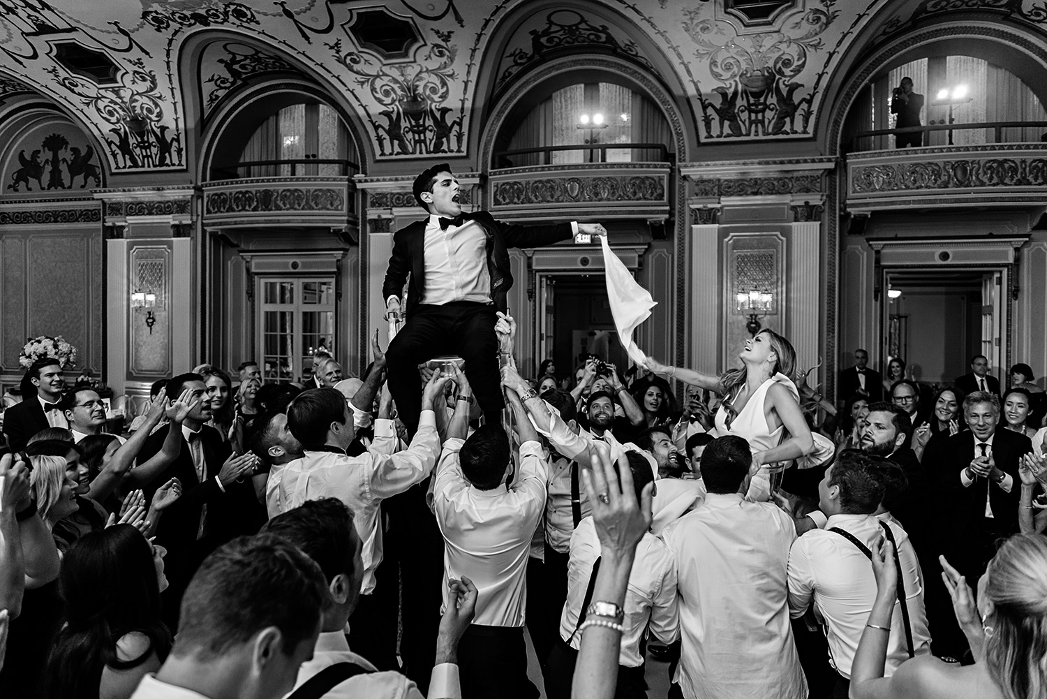 photograph of a bride and groom having a great time hora in the chateau laurier in ottawa