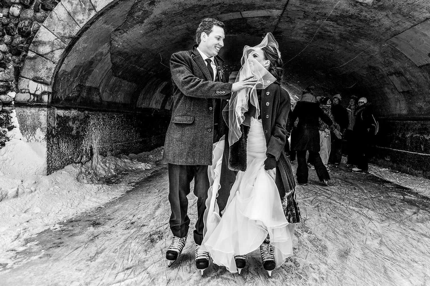 photograph of a bride and groom take a skate on rideau canal ottawa winter wedding