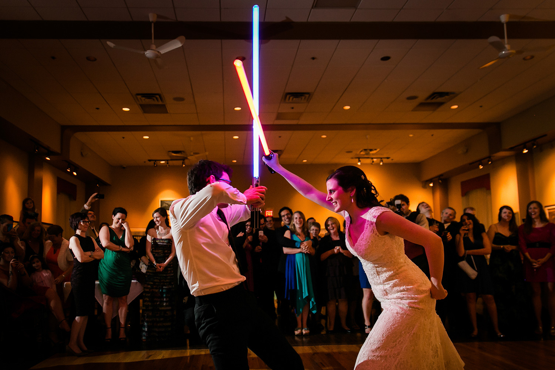 photograph of a starwars lightsaber battle at a wedding reception