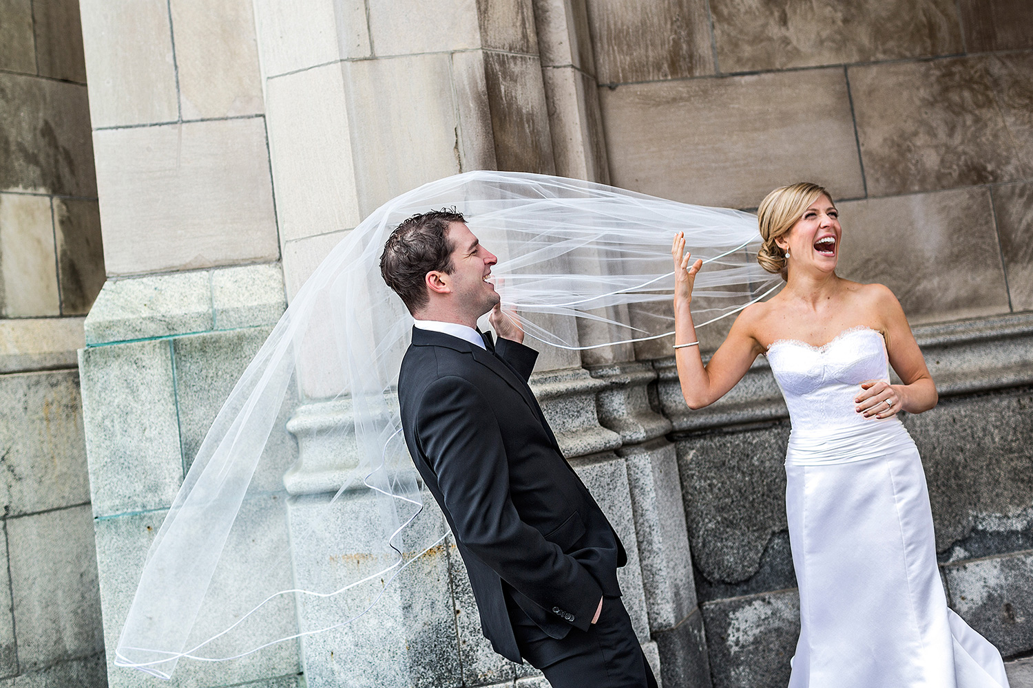 photo of a brides veil blowing in the wind outside the chateau laurier while seeing her groom for the first time