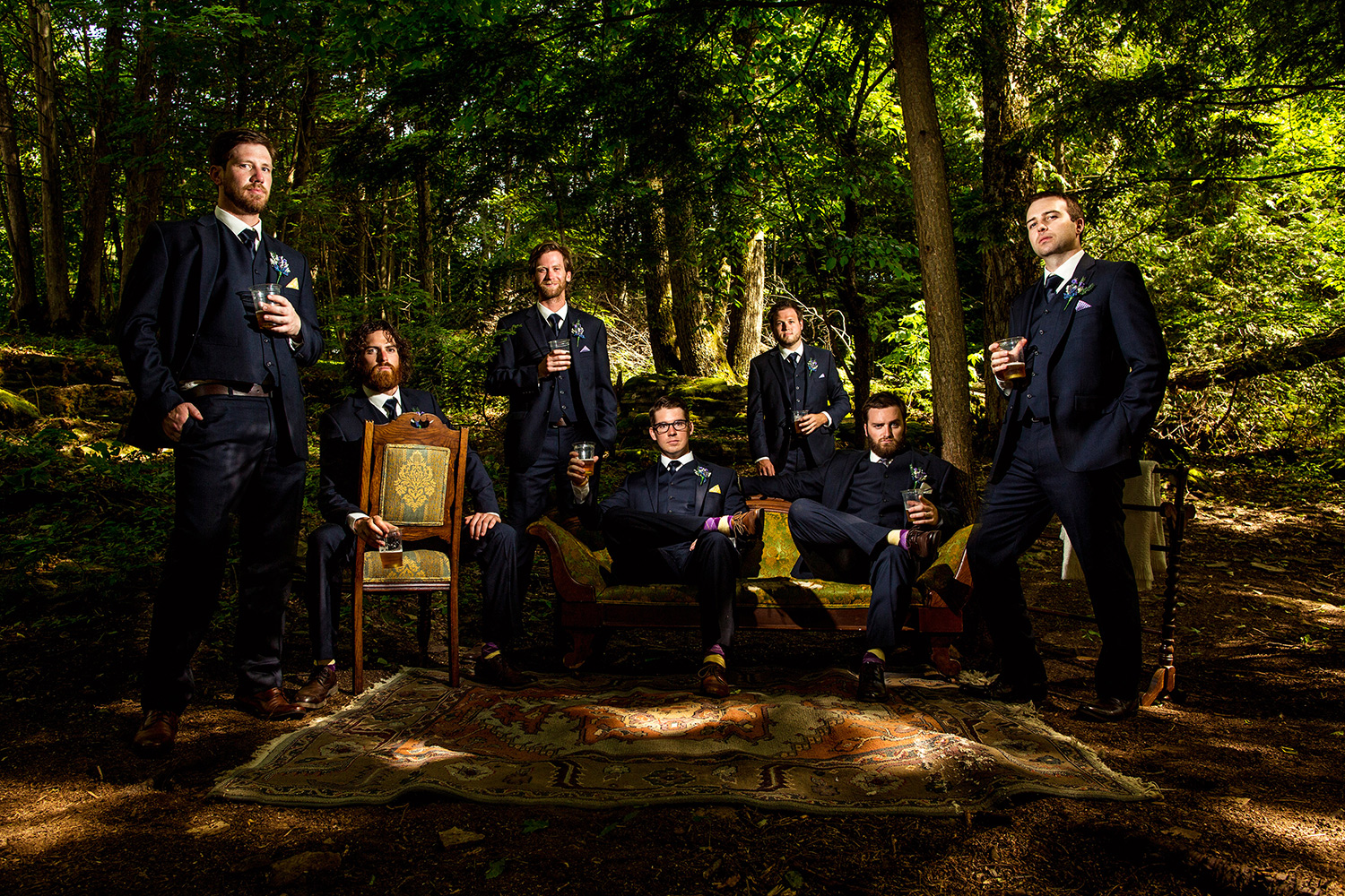 photograph of groomsmen in a forest at a cottage wedding
