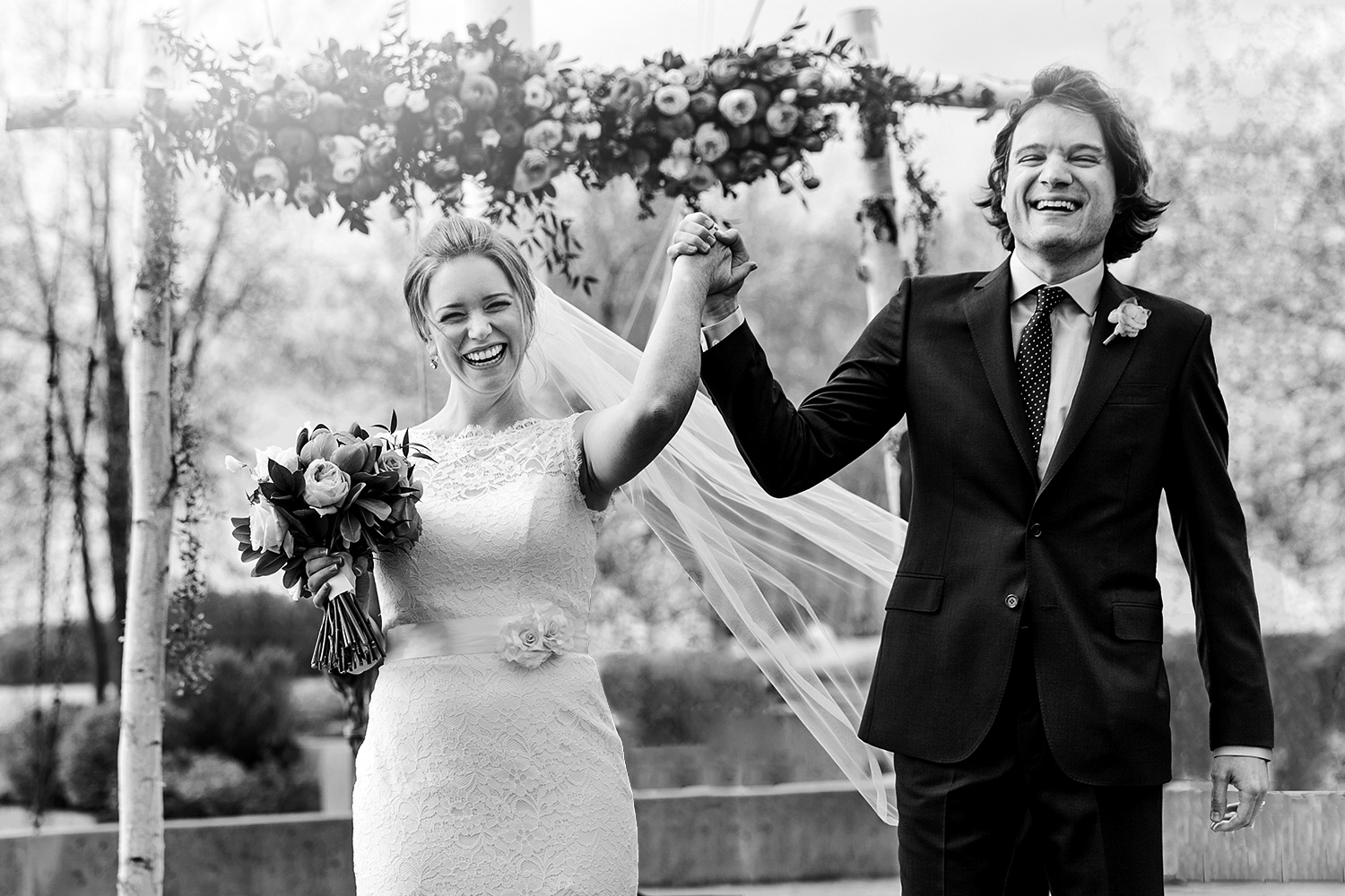 wedding photograph of a happy bride and groom having just been pronounced husband and wife