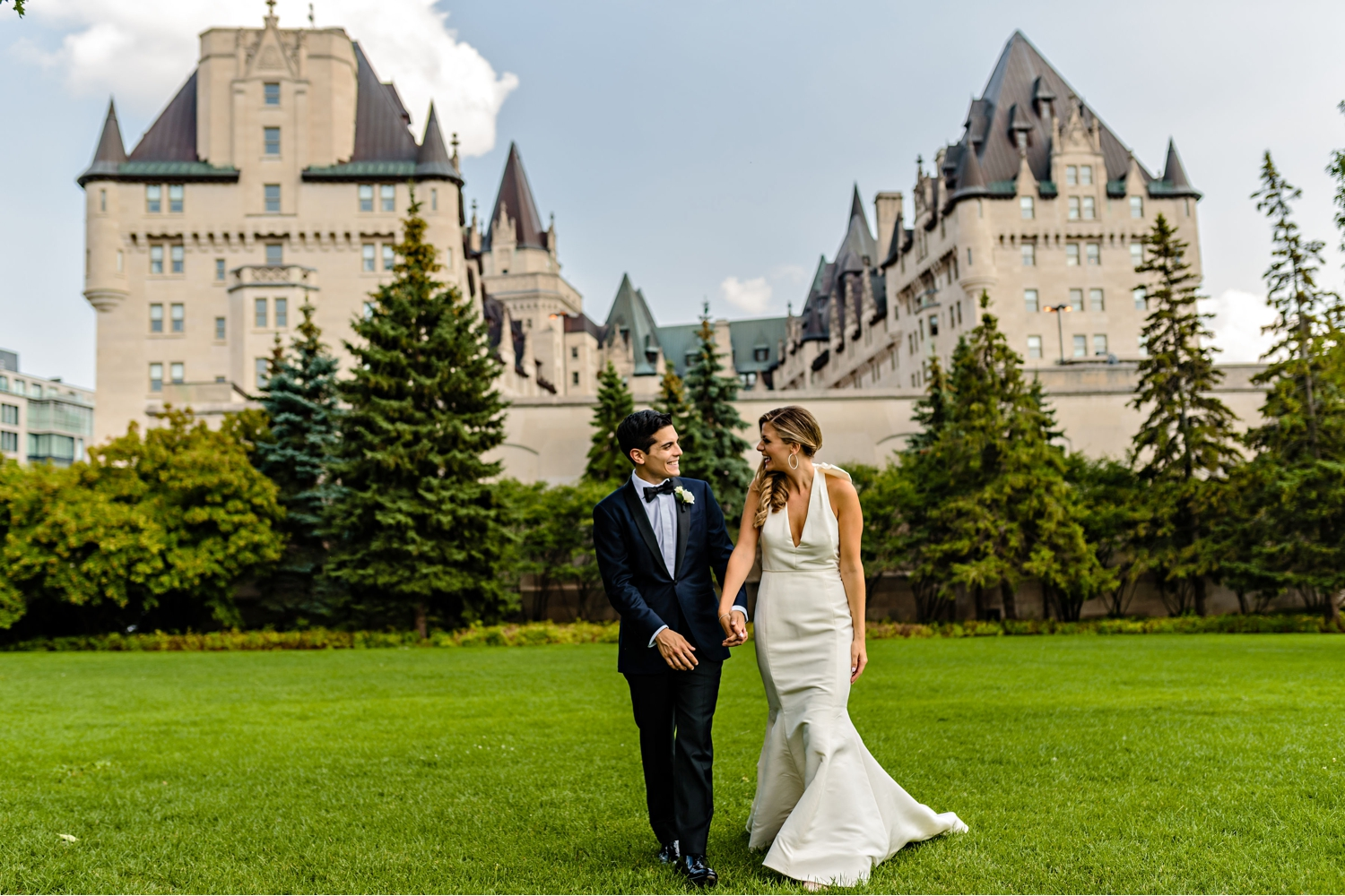 photo-of-bride-and-groom-with-the-chateau-laurier-in-the-background.jpg
