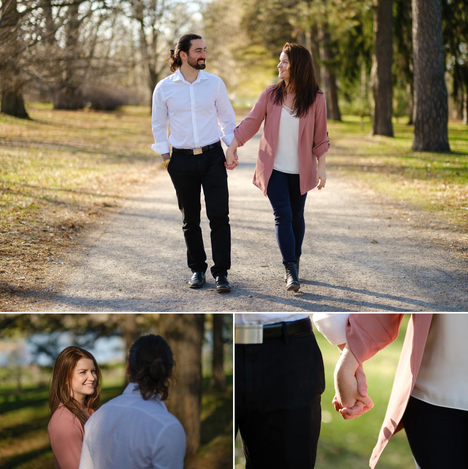 happy couple walking through the arboretum during their engagement shoot