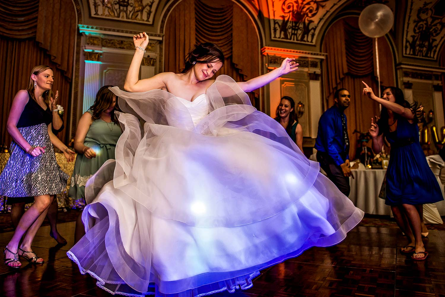 Photograph of a bride dancing at the reception of her chateau laurier wedding