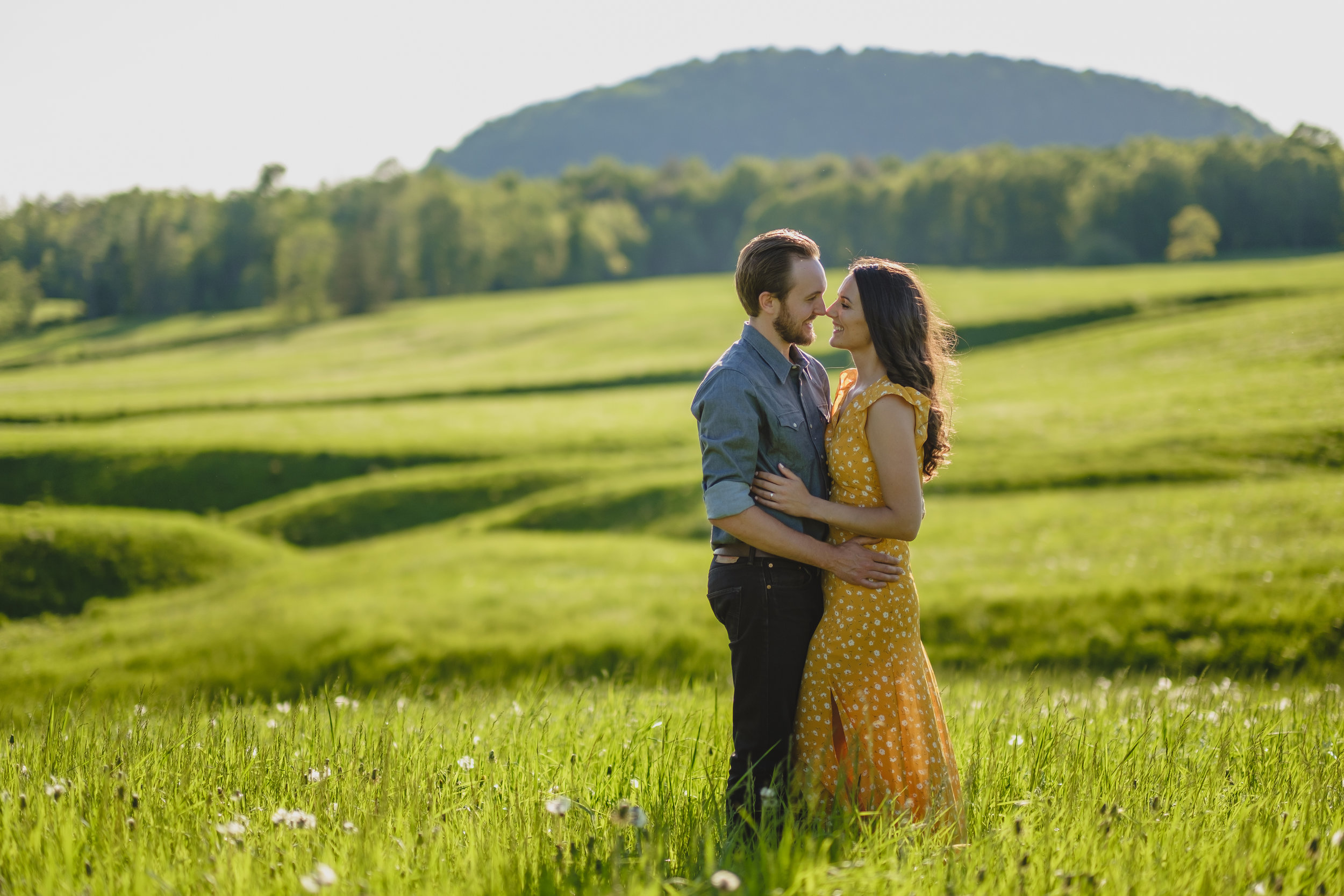 engaged couple in a farmers field in harrington quebec