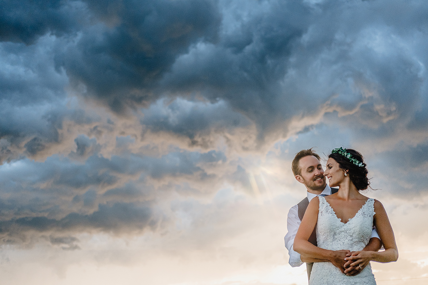 photo of bride and groom with a stormy sky during a metcalfe ontario wedding reception