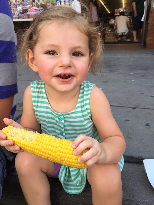penelope has refused corn on the cob all summer. she finally decided to try some of mine. not only did she eat my snack, but i let her know that she's been missing out all summer long.