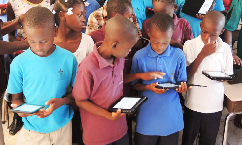 Students at Restavek Freedom have access to over 2,000 books in Creole, French, English, Spanish on Library For All's digital library for Haiti.
