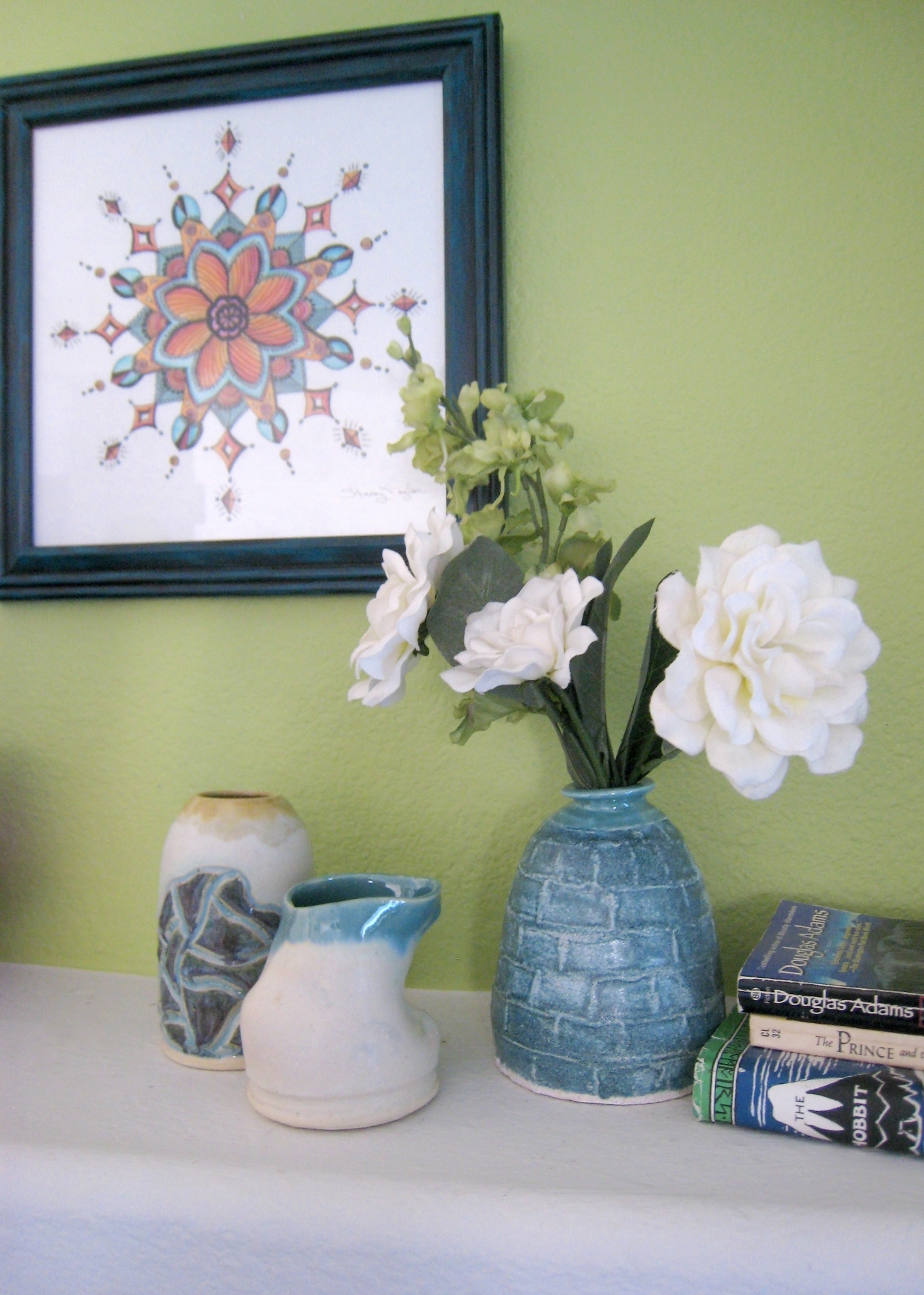 "Art & Styling by Stacey Taylor of Effortlessly Eclectic  ""Diamond Flower Mandala"" wall art  ""Map Vase in Cream, Light Blue, & Sage"" pottery  ""Squished Bud Vase in Soft White & Robin's Egg Blue"" pottery  ""Blue Bottle"" pottery"
