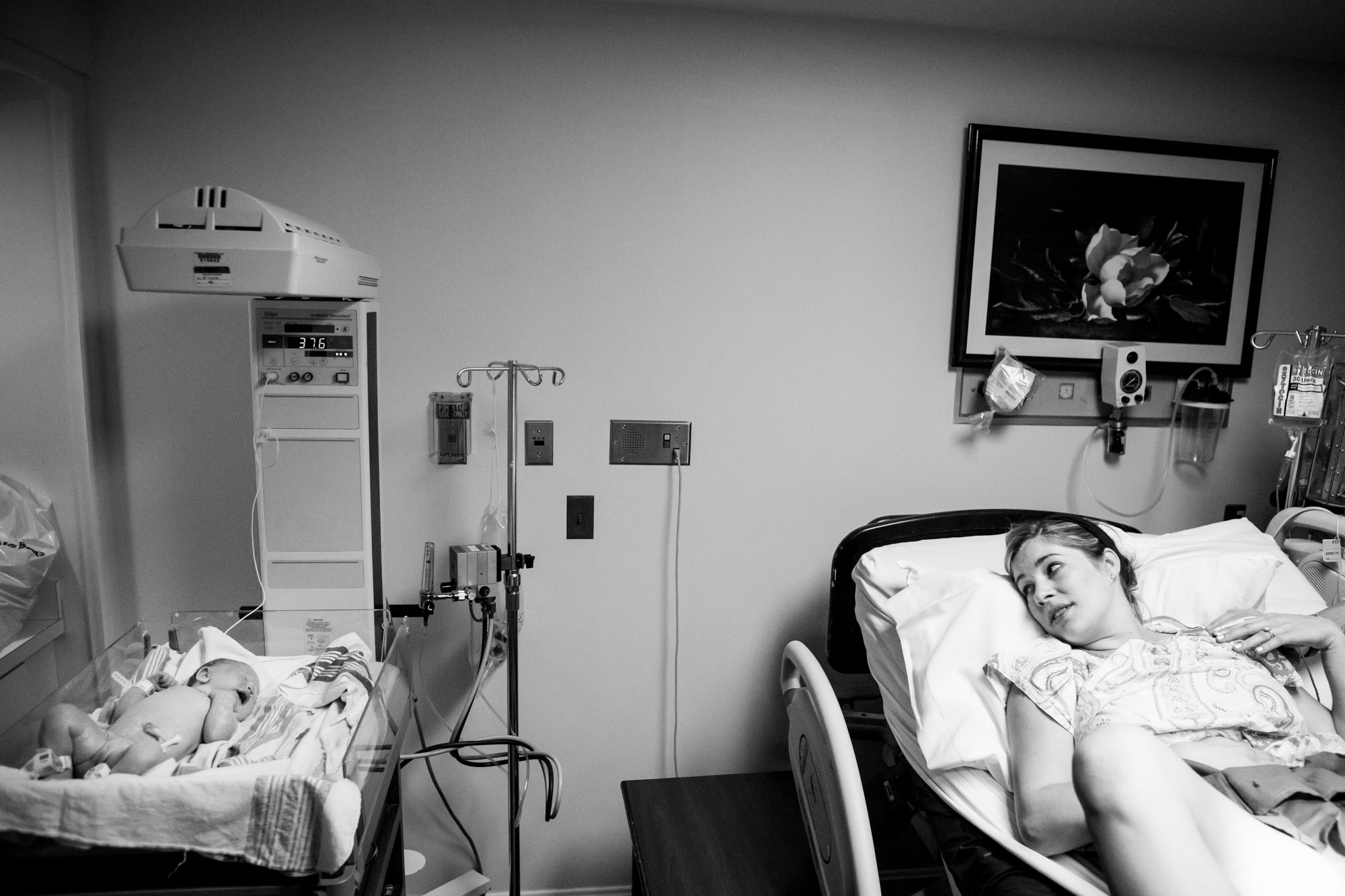 mom looking at her newborn baby
