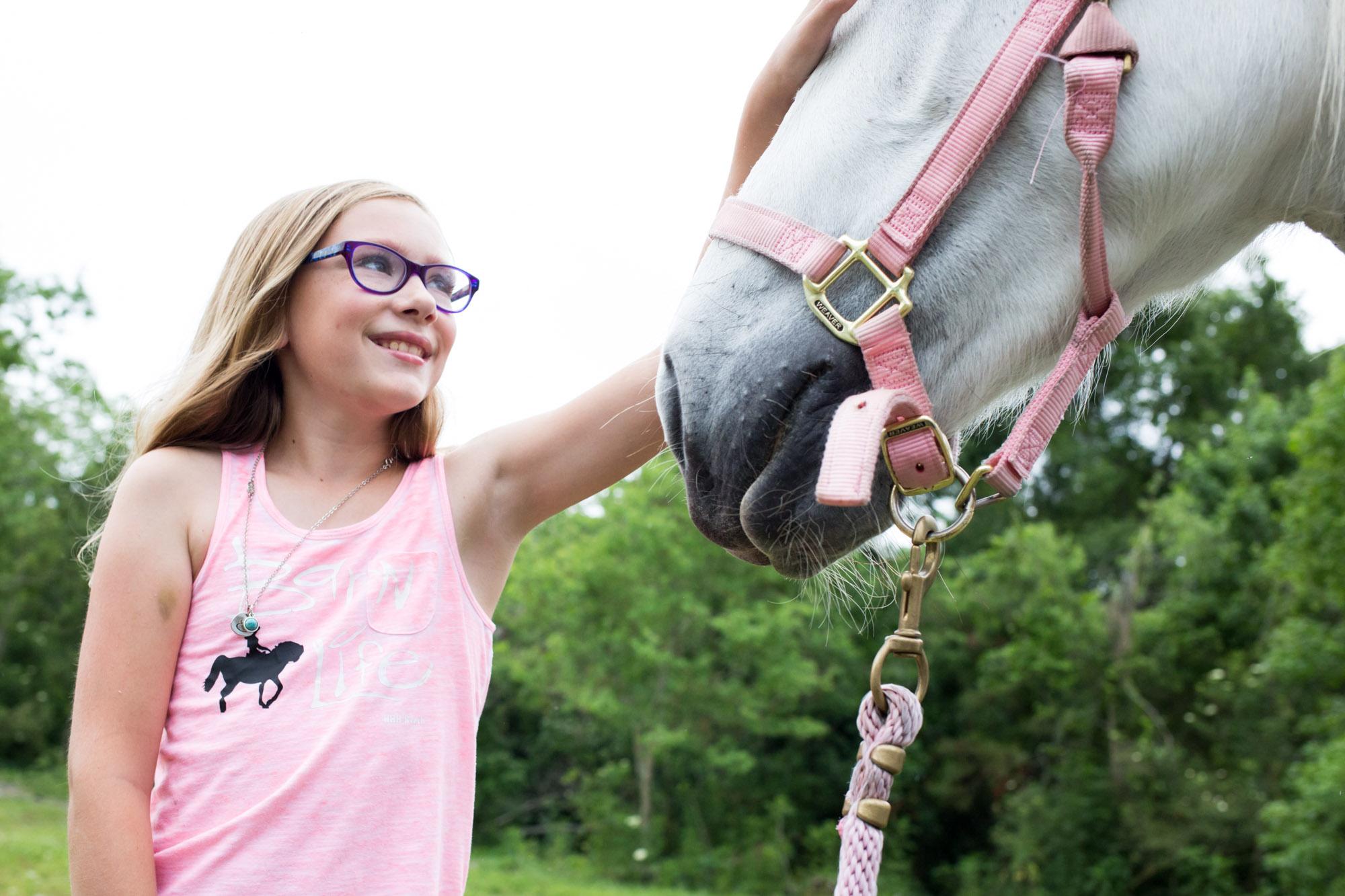 girl admiring her horse