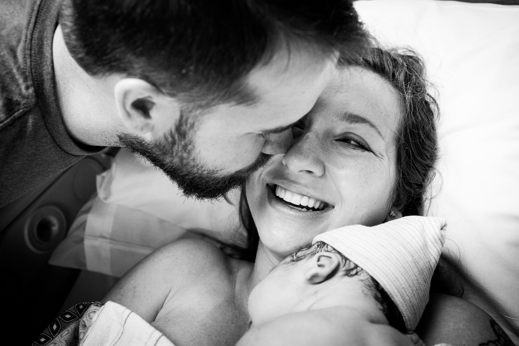 parents kissing after baby born at Shands Gainesville