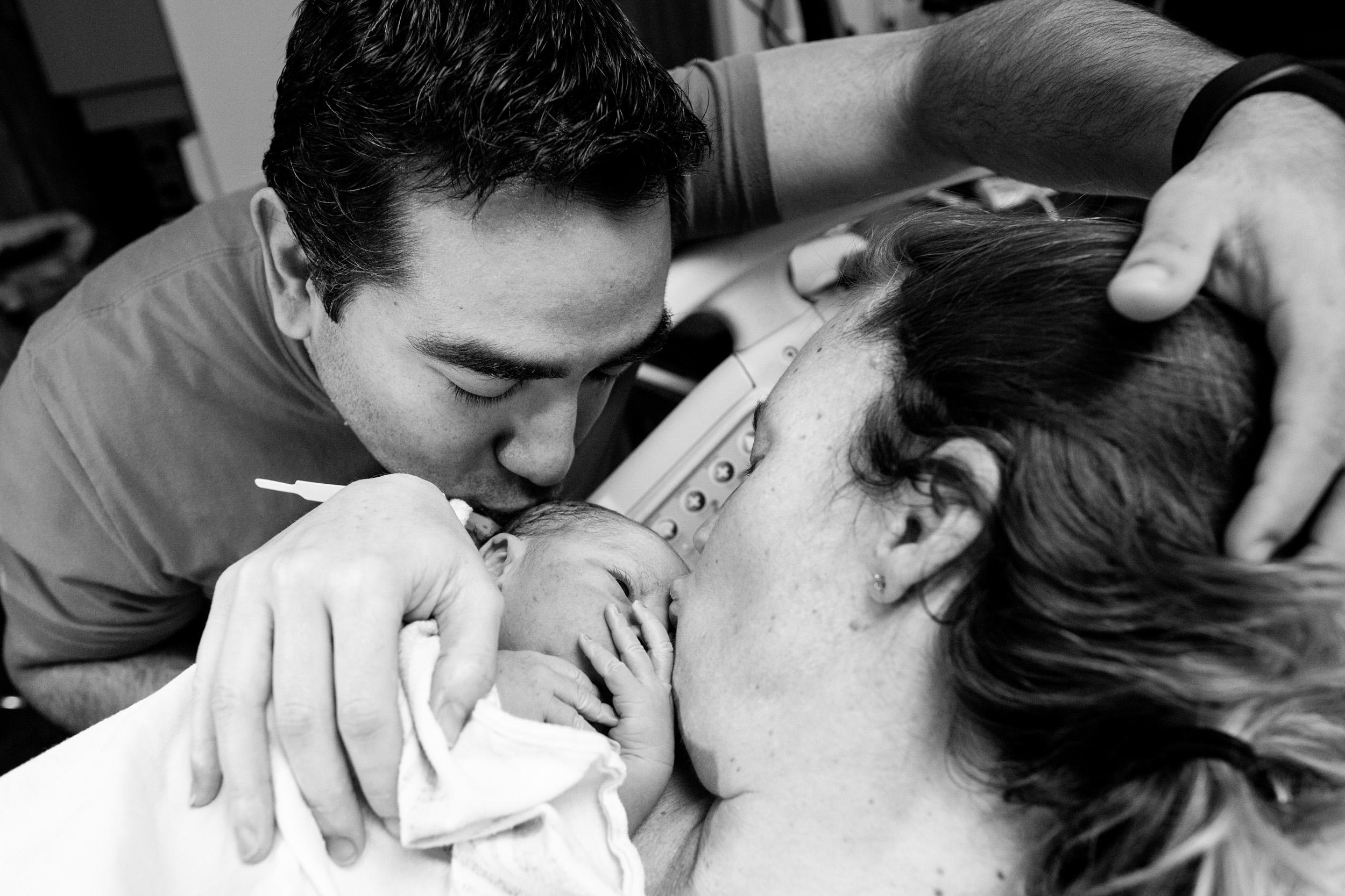 jacksonville parents kiss newborn baby