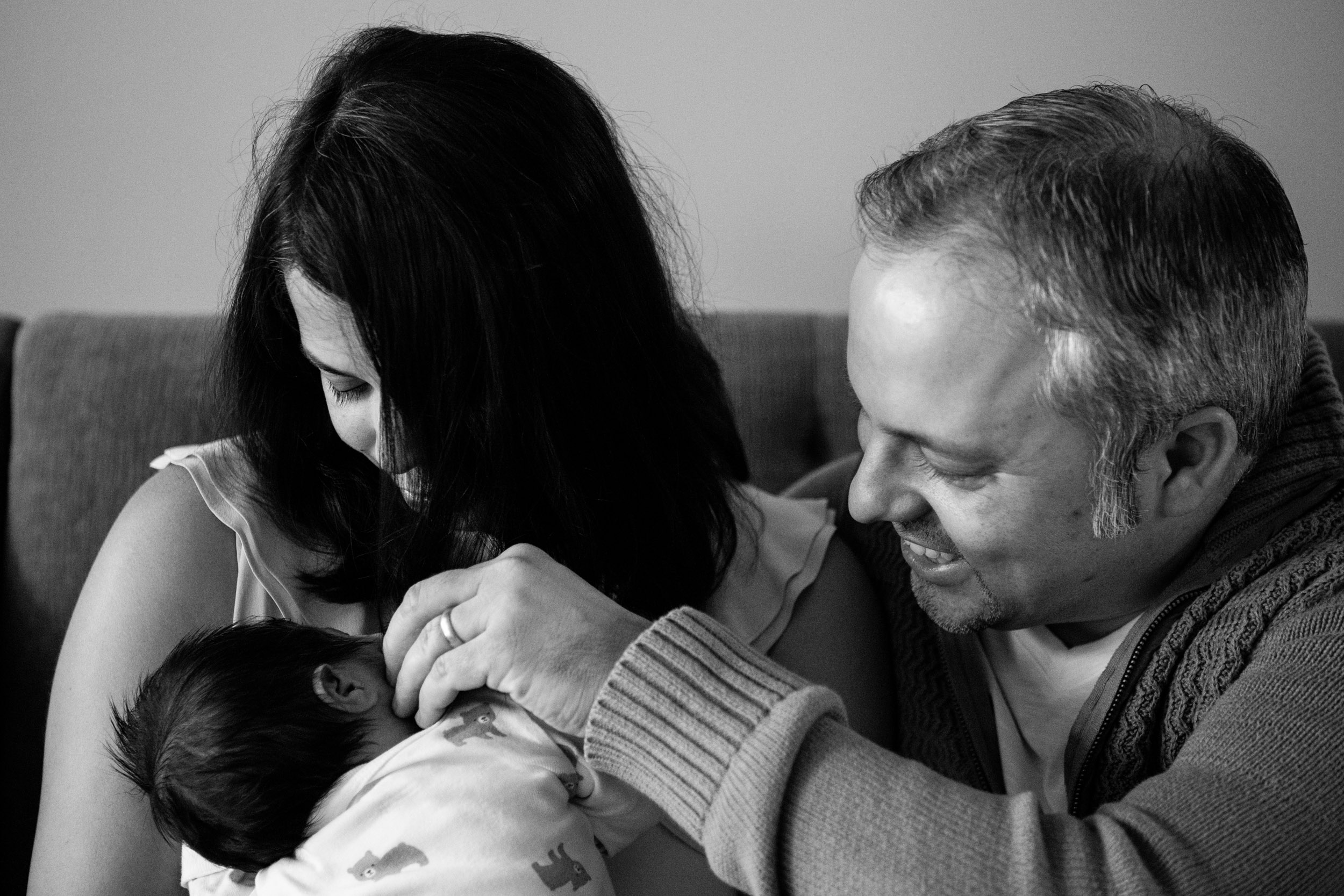 new parents with their newborn