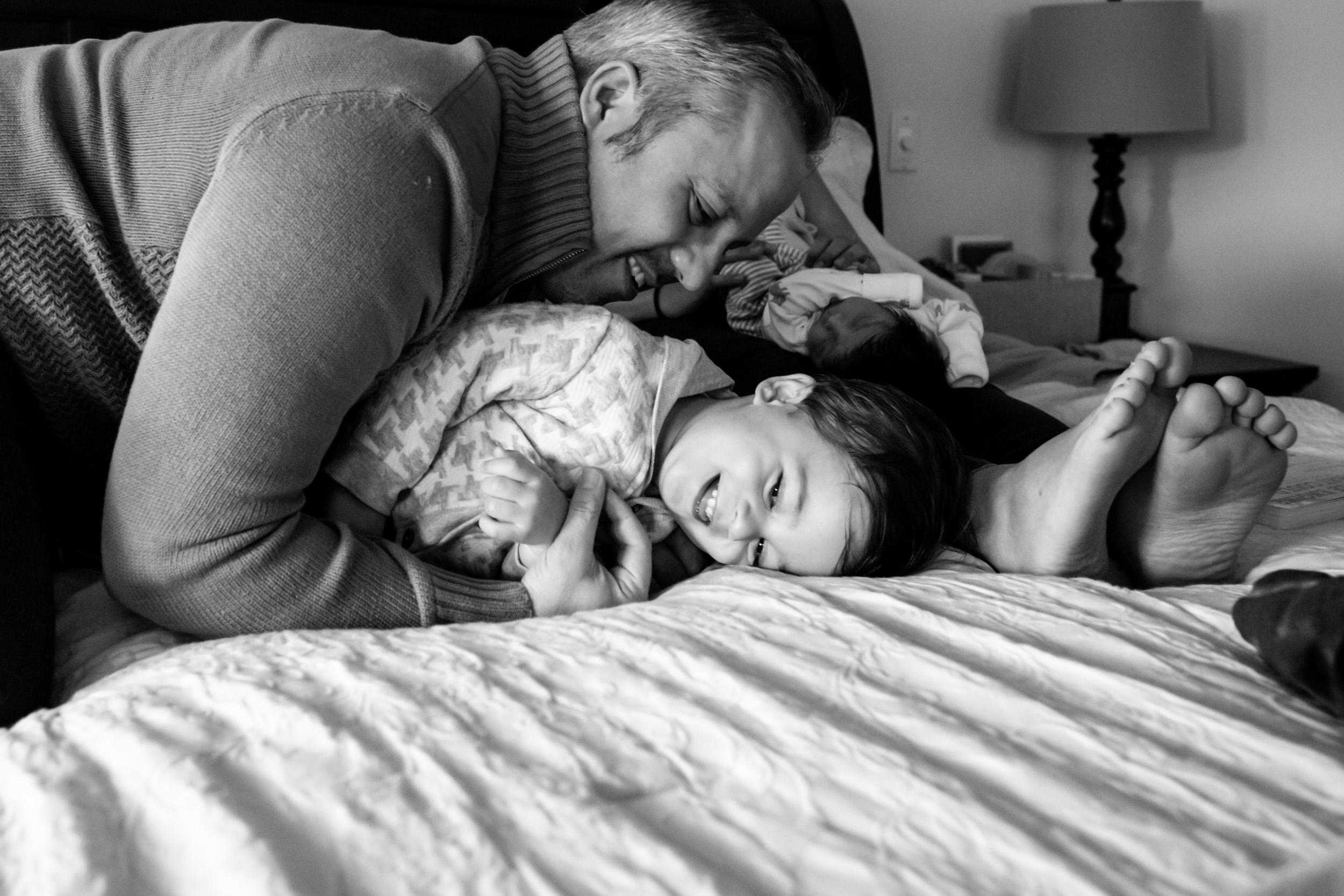 dad tackling his little boy
