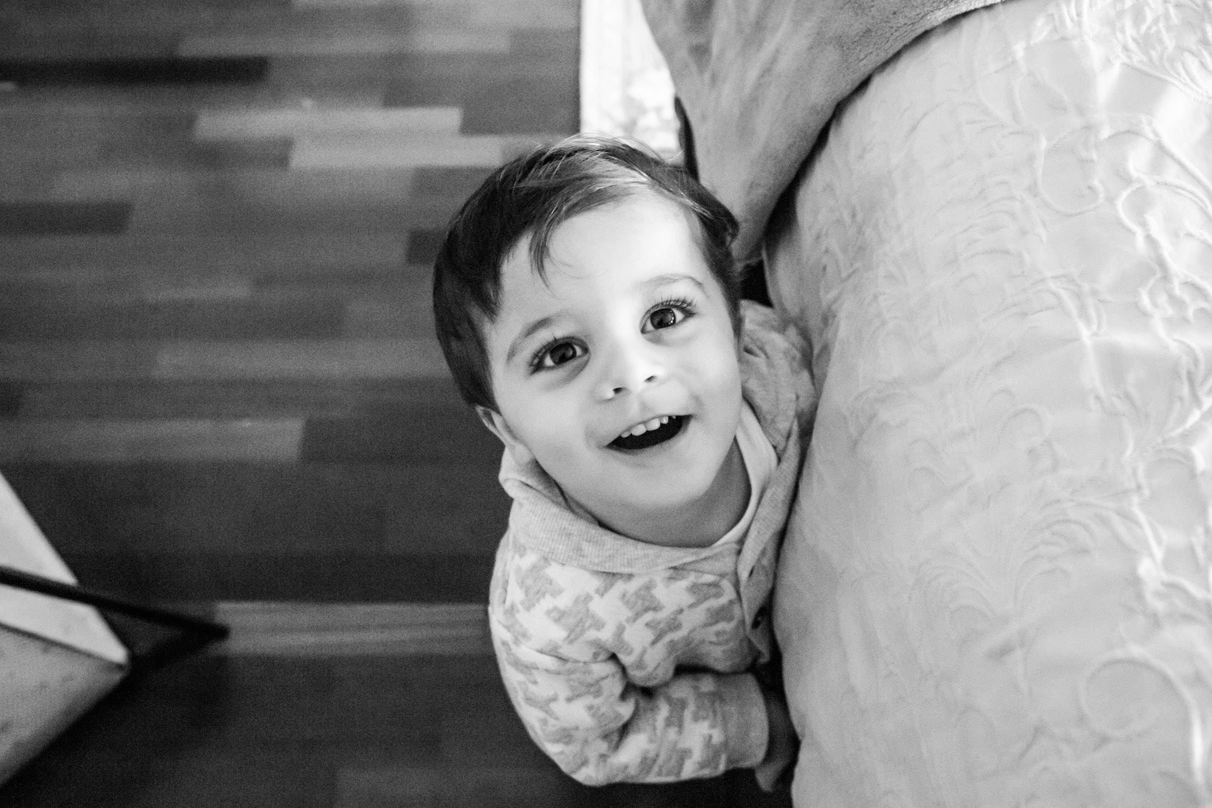 little boy looking up at camera and smiling