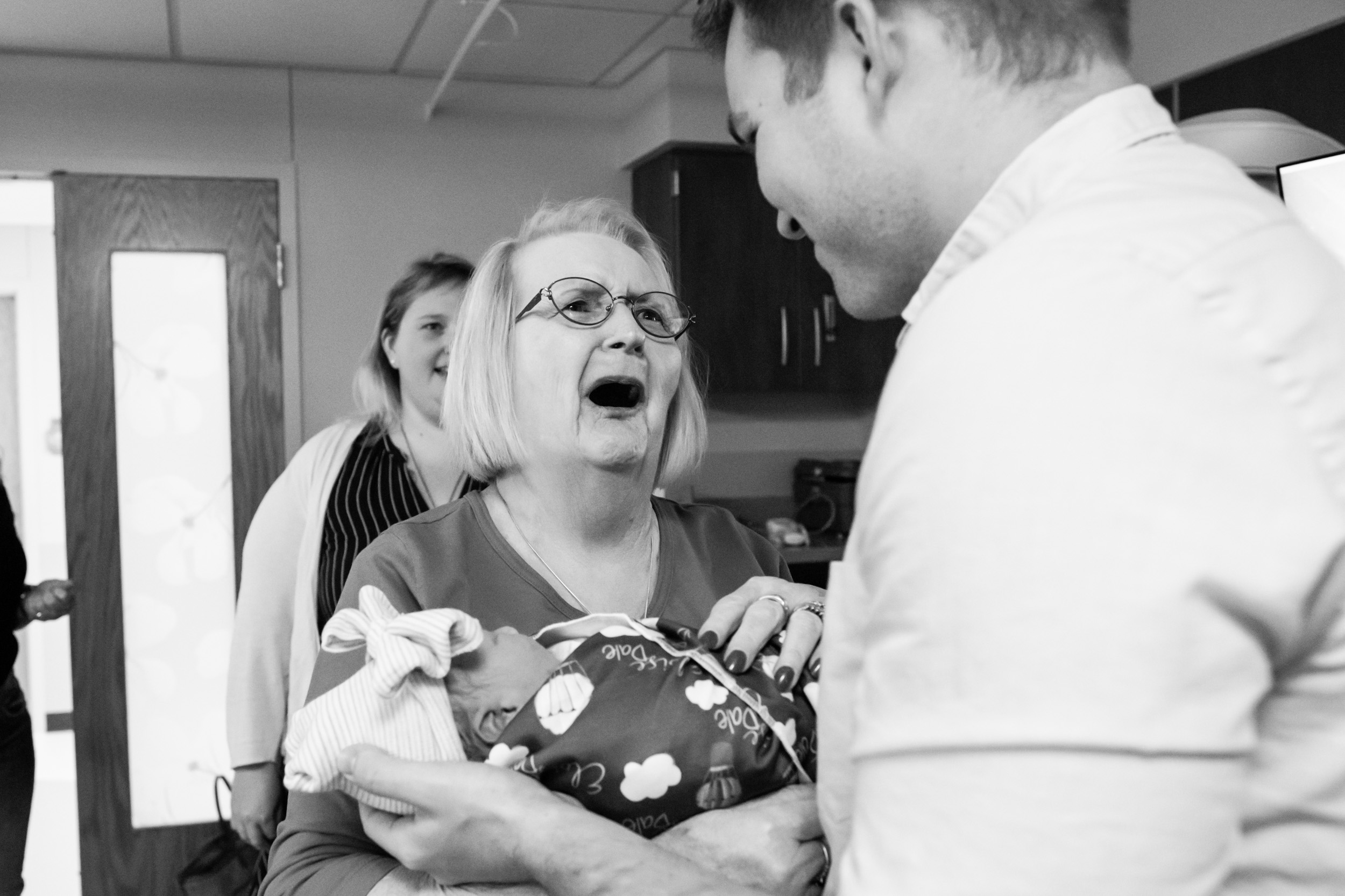 great-grandmother crying with joy after realizing baby's middle name is her late husband's name