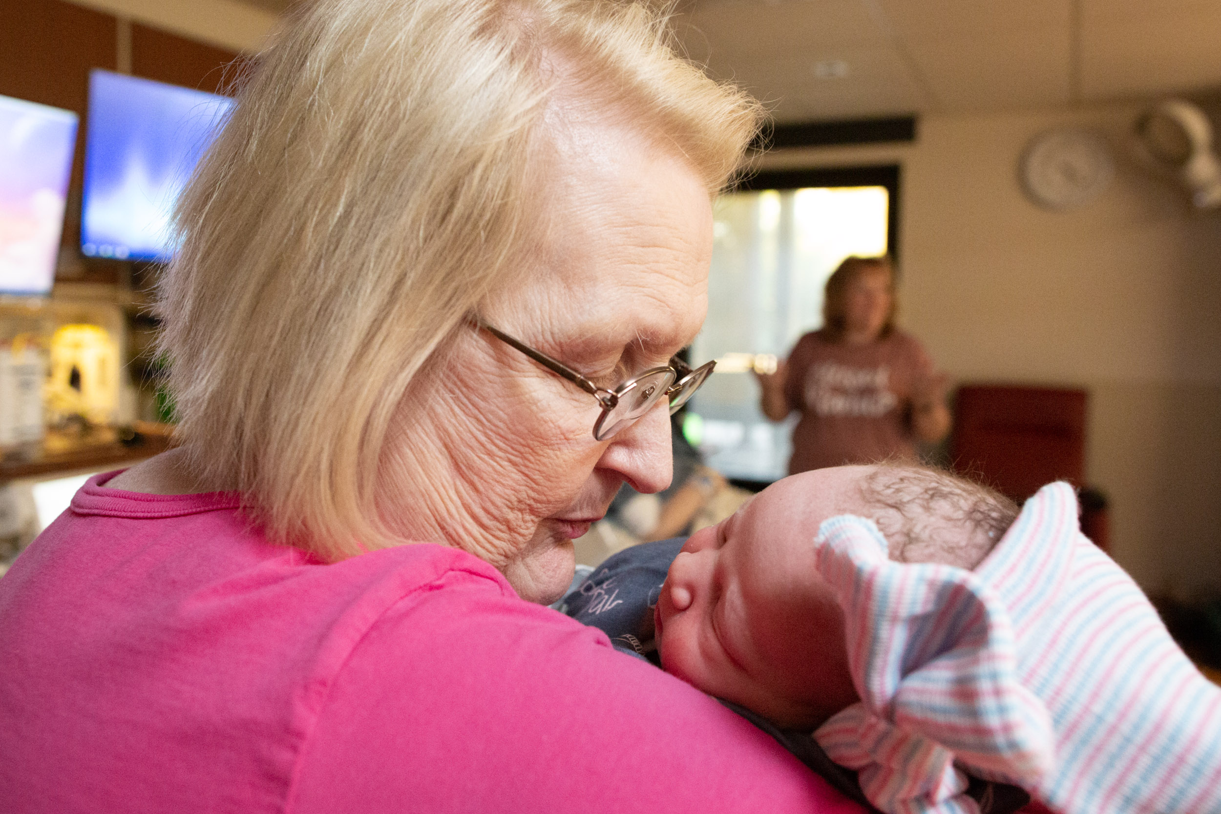 great-grandmother holding newborn baby girl