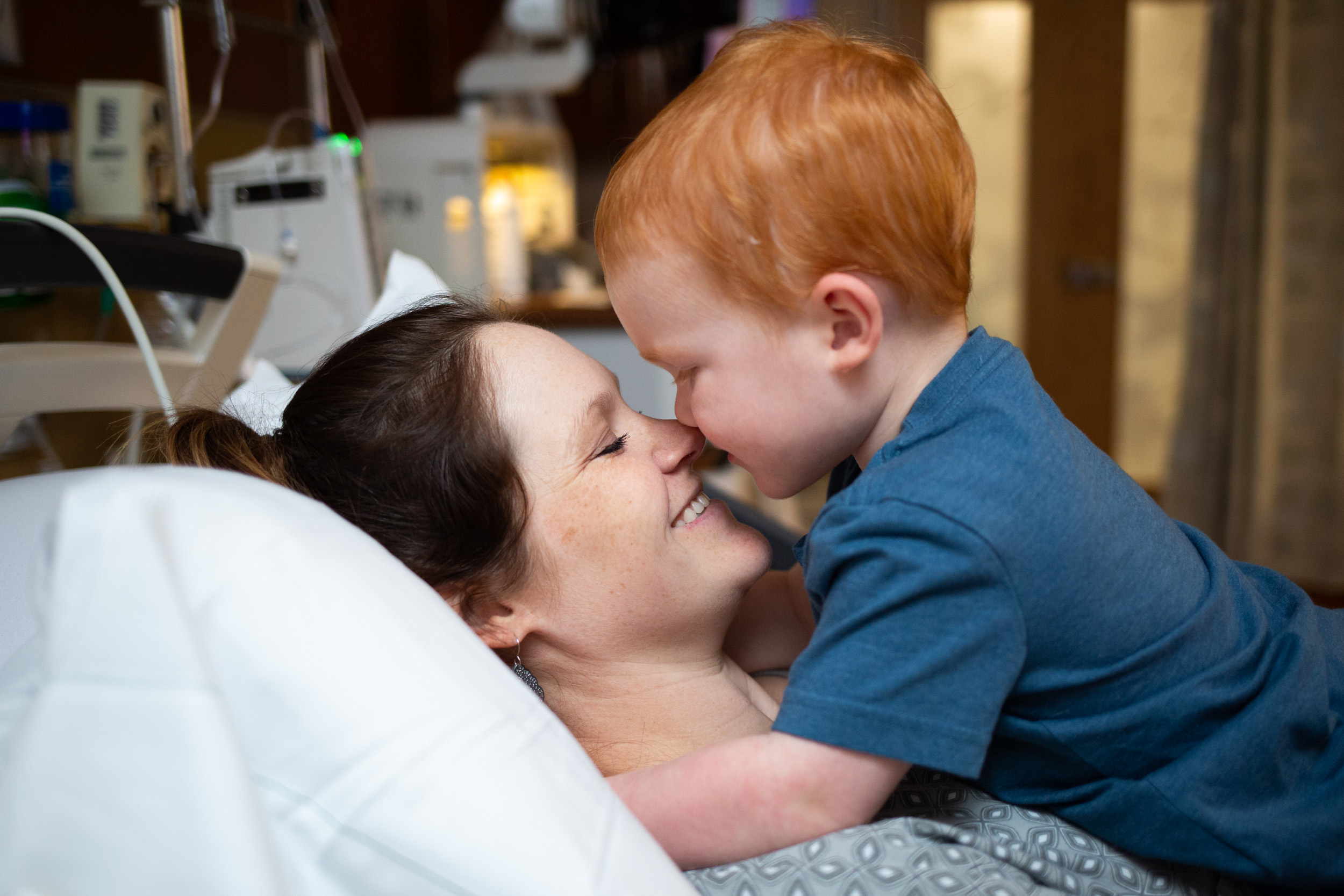 laboring mom with son during hospital stay before birth