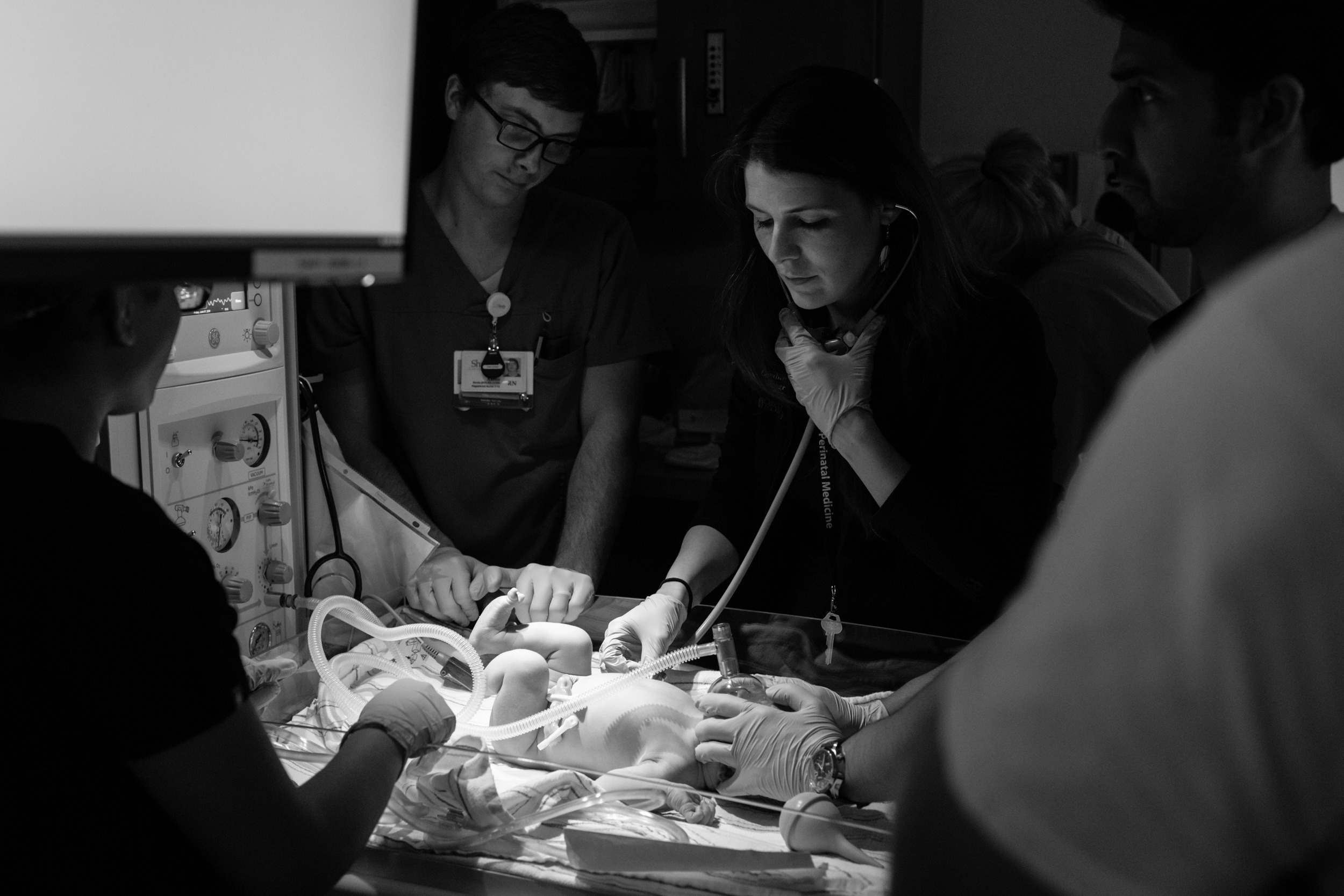 pediatrician checking lungs of newborn baby boy