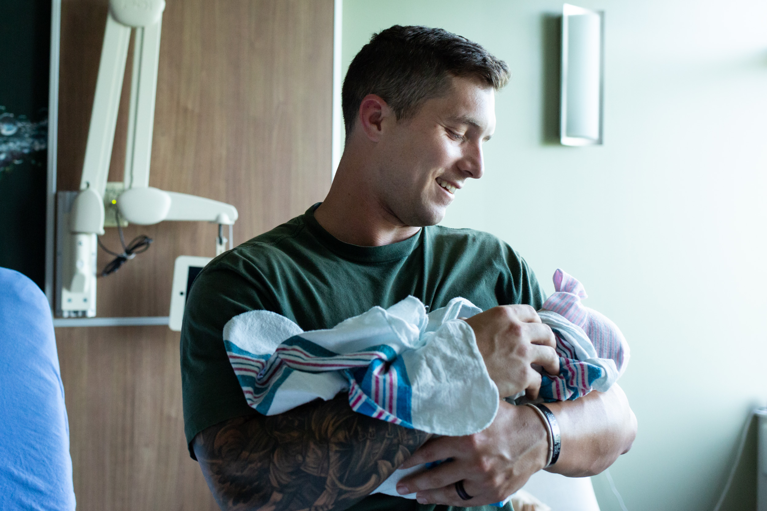 jacksonville birth dad smiling at newborn baby girl