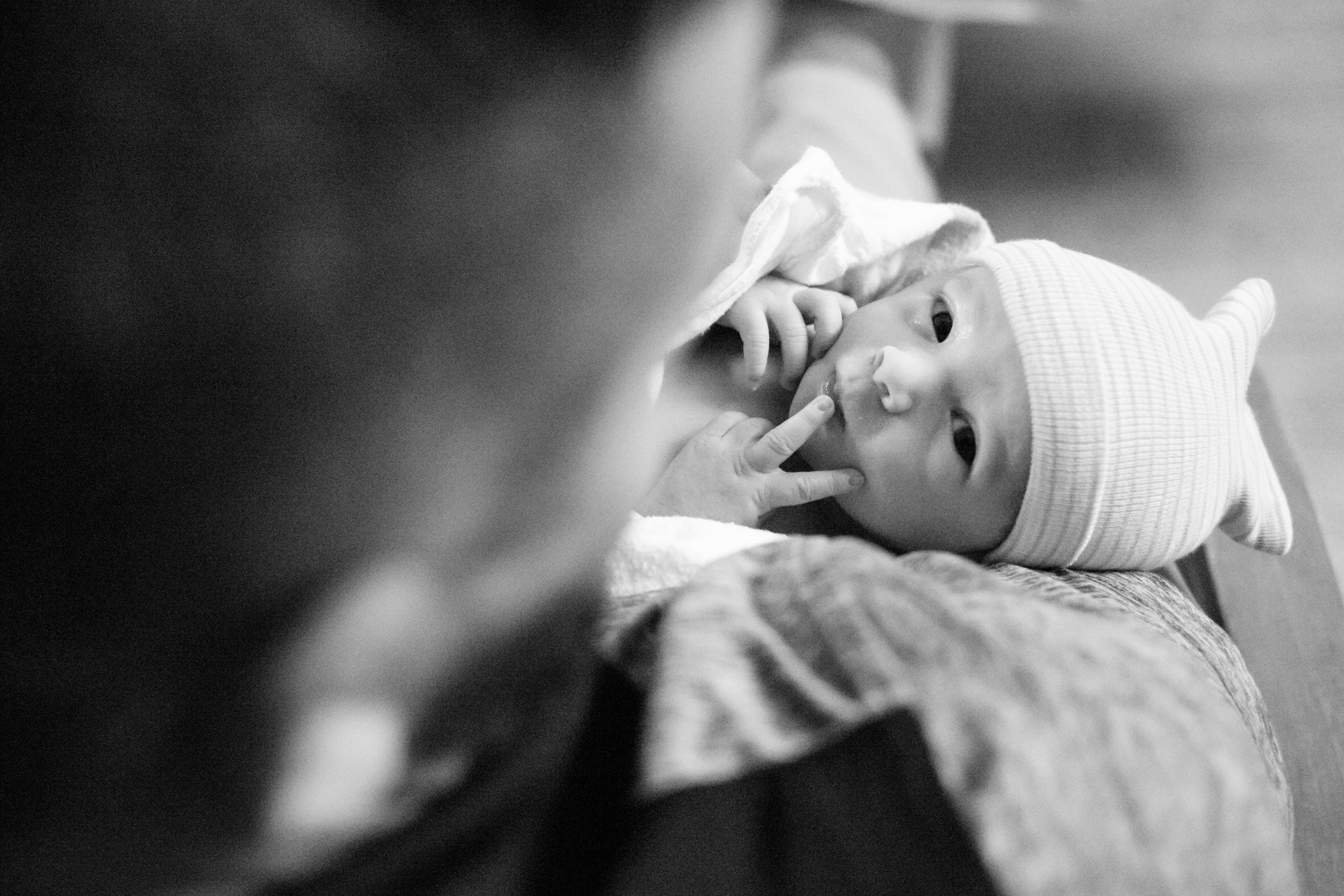 newborn baby looking up at the camera