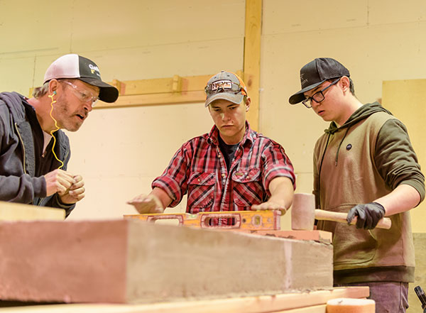 Scotty with Construction Management students.