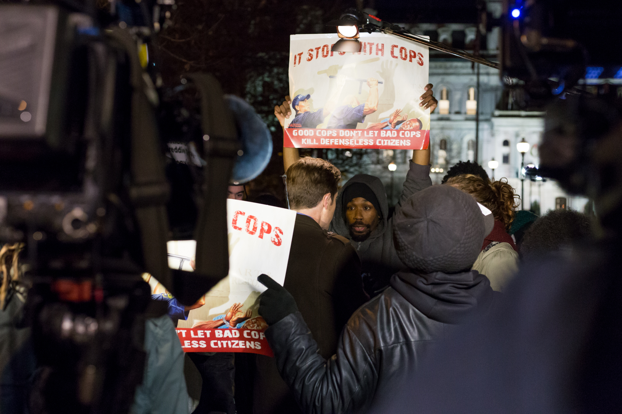Protesters interrupt TV news crews in front of City Hall the night of the Porter mistrial ruling.