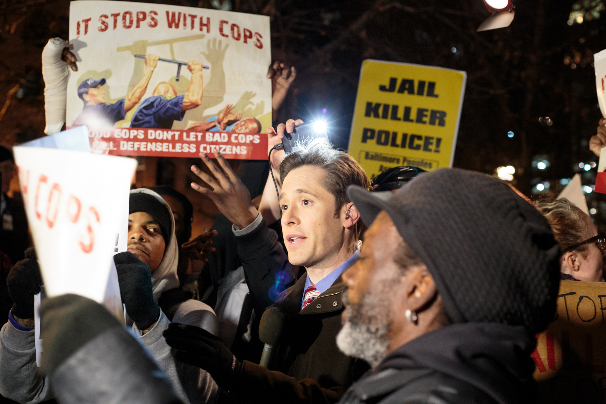 "Protesters at City Hall on Wednesday, Decemeber 16, 2015 stepped in front of television cameras to disrupt news crews and express their distaste of mainstream media's portrayal of ""Baltimore's Uprising."" Earlier that day, judge Barry G. Williams declared the Porter case a mistrial."