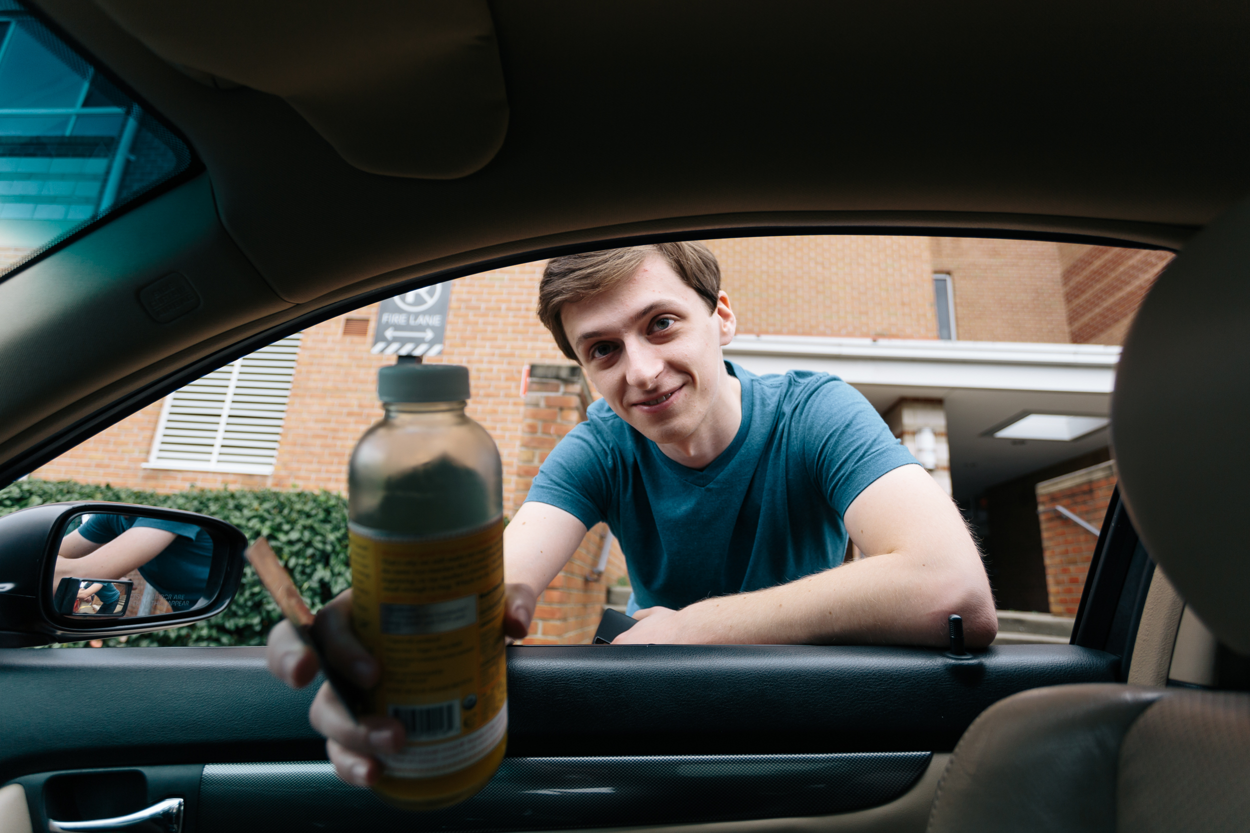 My roommate, Sonny, with Emily's drink. Almost forgot to leave home with out it.