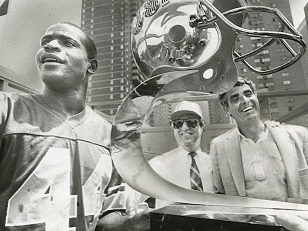 Kelvin Bryant owner Myles Tanenbaum and coach Jim Mora celebrate the Stars championship during a celebration on July 16 1984.jpg