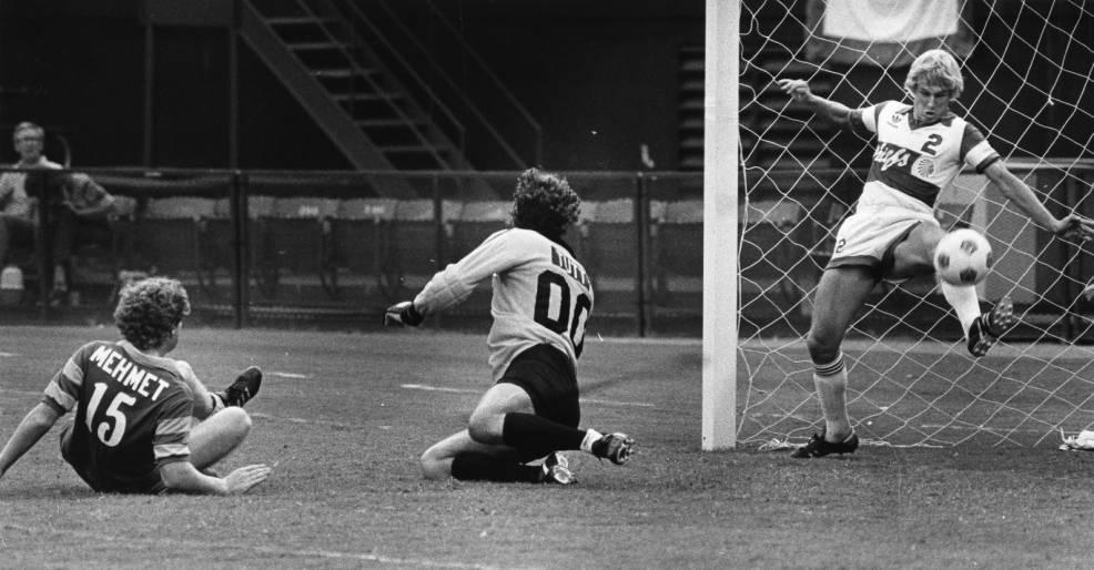 Chiefs Bruce Savage clears the ball in front of the goal against the Rowdies in 1981.jpg