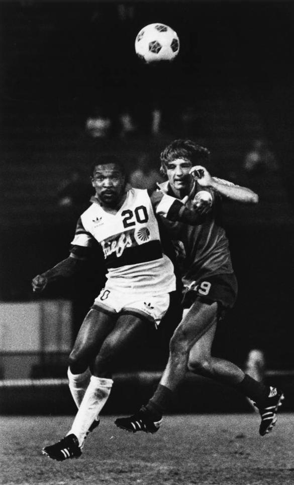 Webster Lichaba left of the Chiefs and Nino Zec compete in a 1981 match.jpg