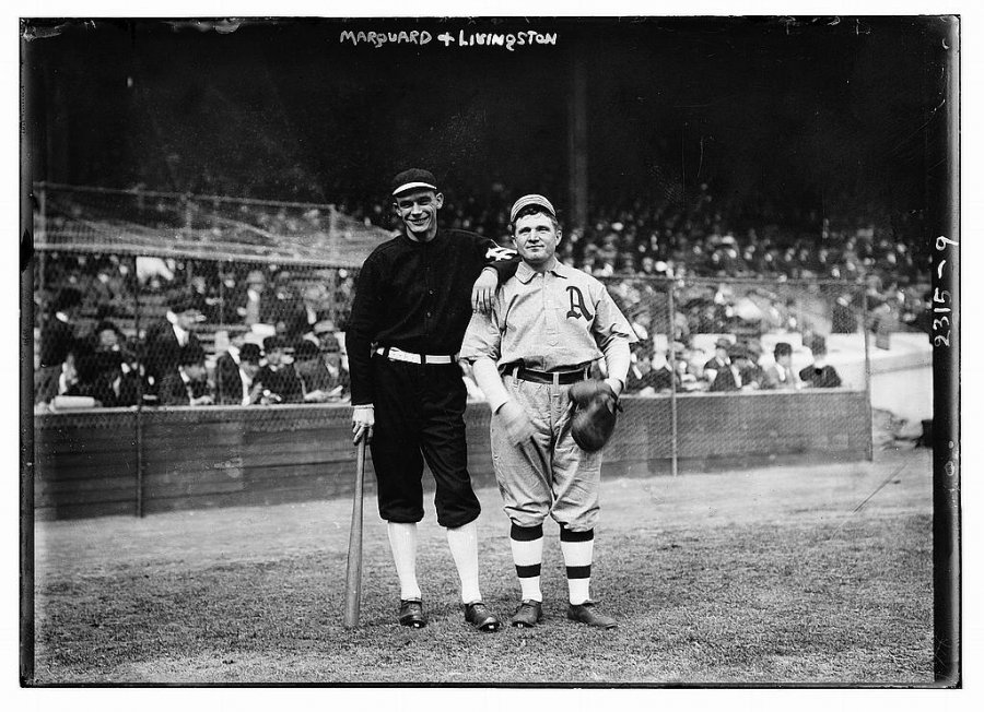 a-giants-player-and-an-as-player-pose-before-competing-in-the-1911-world-series.jpg
