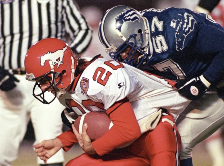 doug-flutie-and-o-j-brigance-during-the-1995-grey-cup.jpg