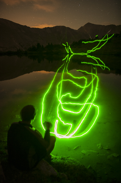 Pierce Martin shows off Mike's green laser pointer at a pond near Loveland Pass, Colorado.