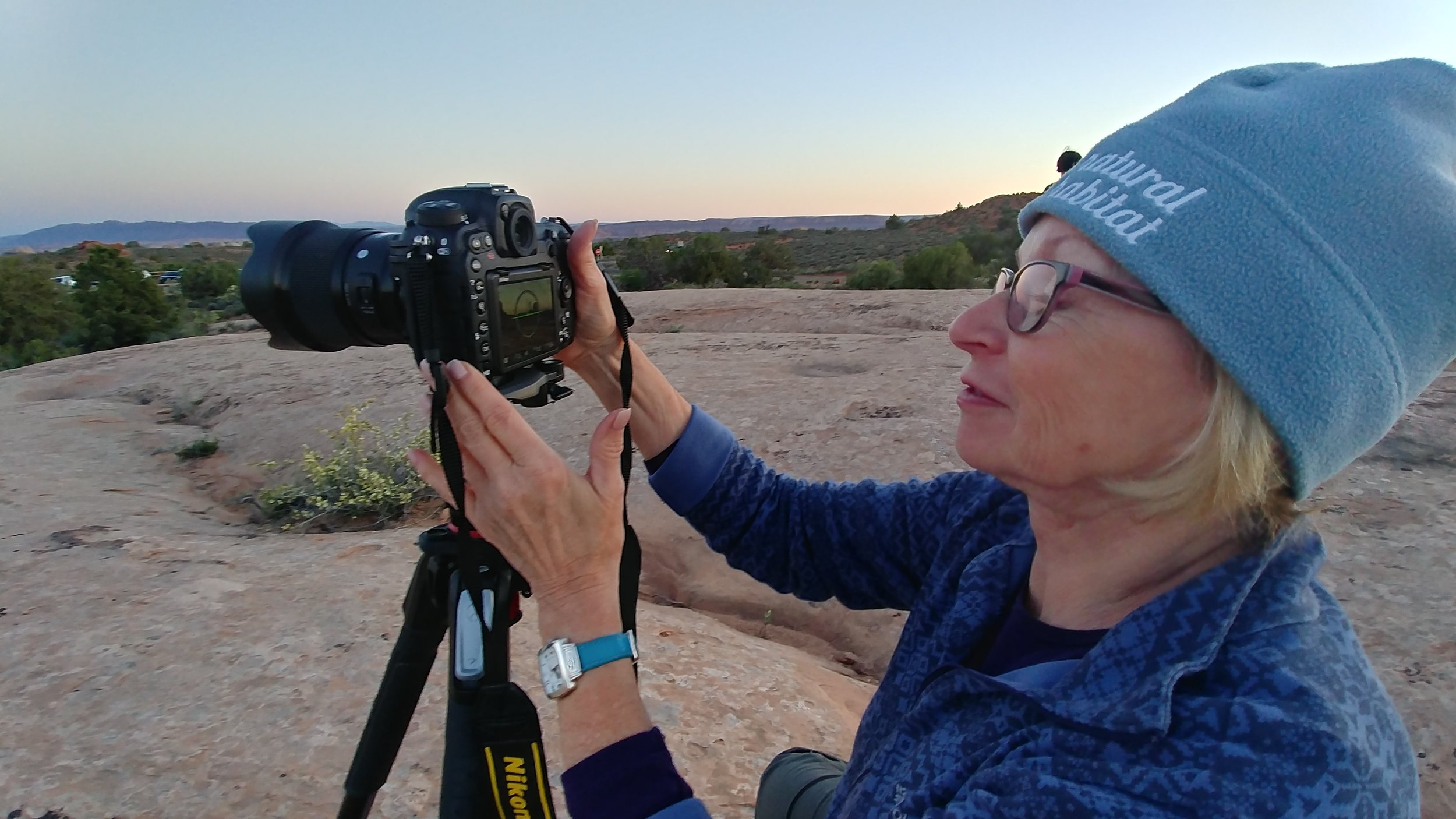 Night photography student Linda Haehnle adjusts the settings on her Nikon D500 during a workshop in Arches National Park.