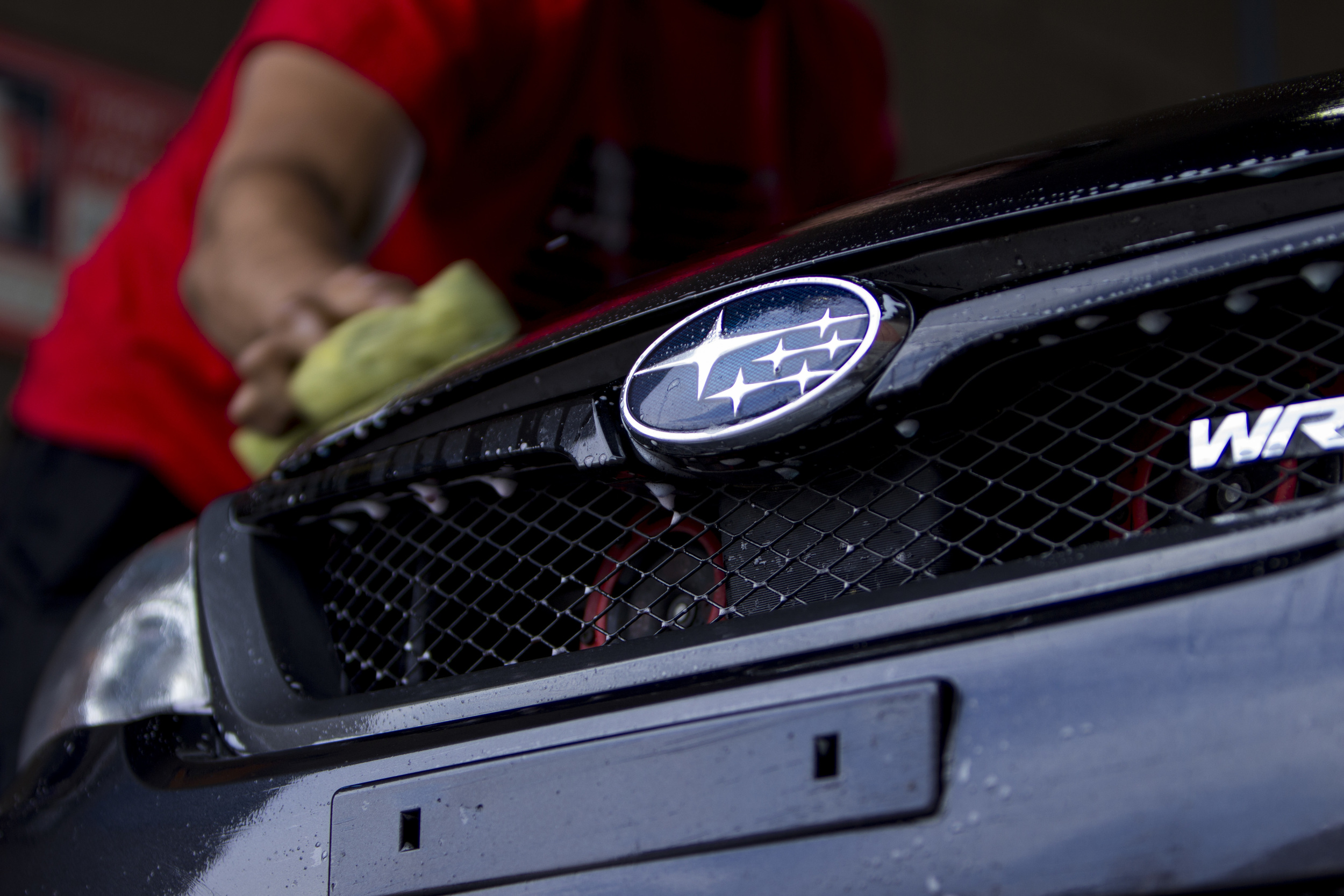 Elliott drying off his Subaru WRX.