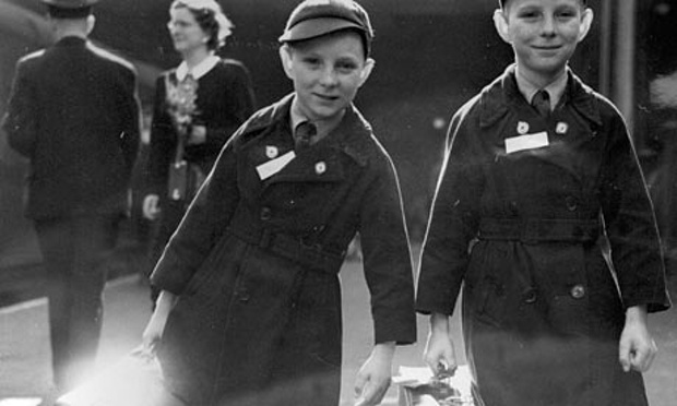 Ten-year-old twins Brian Thomas Sullivan (left) and Kevin James Sullivan from Islington, London, carry their luggage to the boat train at Liverpool Street station bound for Auckland, New Zealand, under the Child Migrant programme. Photograph: AP