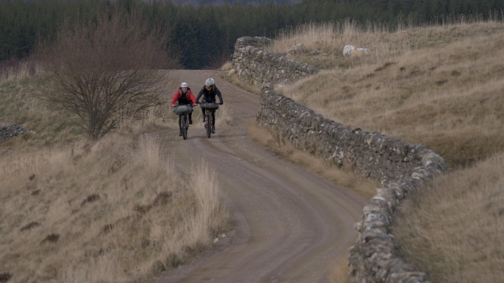 Jenny and Lee bike and curvy wall.JPG
